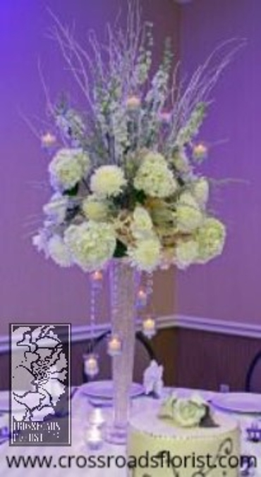 Hanging votives elevated centerpiece