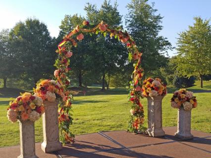 reds & golds outdoor wedding arch
