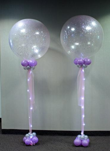 Lighted tulle giant balloon topped columns