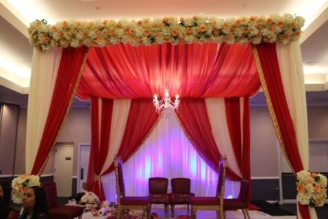 Red & white Mandap with floral hedge