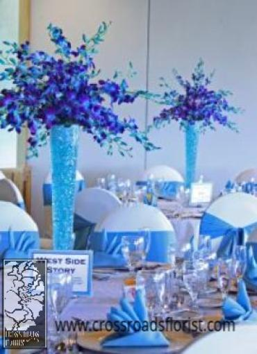 Blue orchids elevated centerpiece