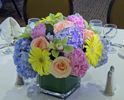 Lush colorful spring cube centerpiece