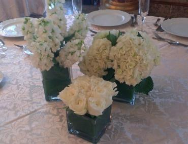 triple white centerpiece composit