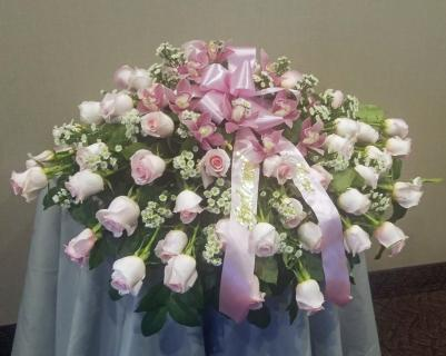 Rose & orchids casket spray in pinks