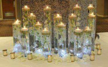 Many candles place card table arrangement