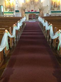tulle swags on pews