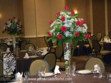 Classic roses & babies breath elevated centerpiece