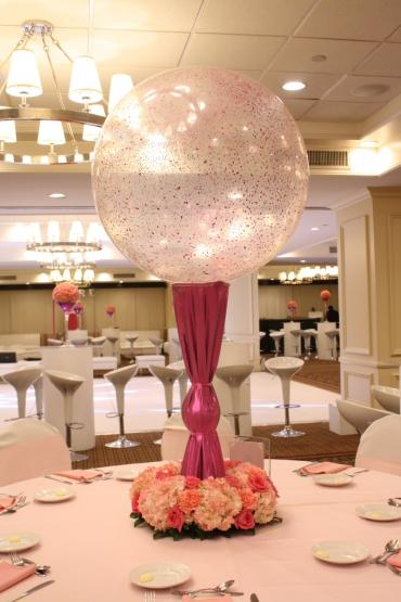 Pink crystal ball centerpiece with flowers